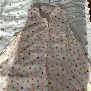 Adorable sleeveless silk blouse.